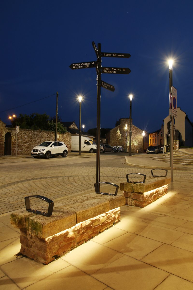 Peel Town Square Regeneration Signpost and benches at night