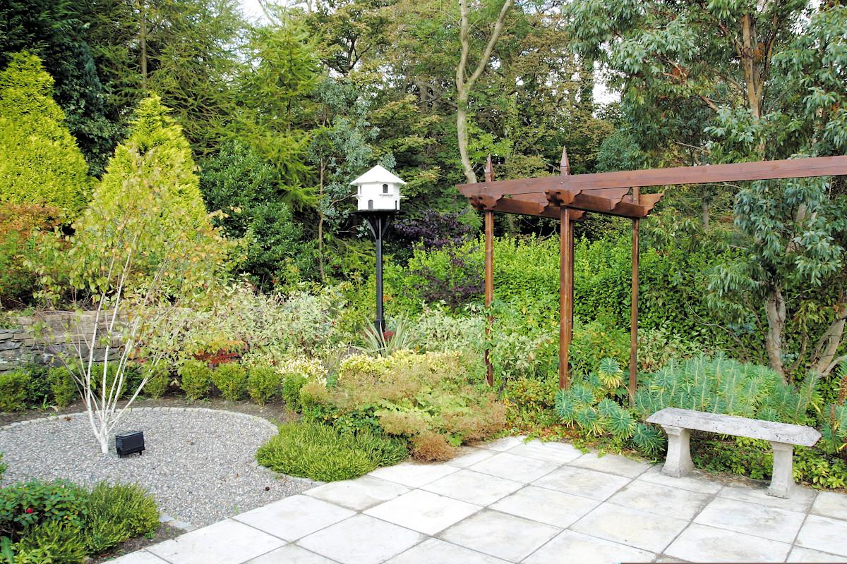 Beaufield House garden design bench patio and pergola