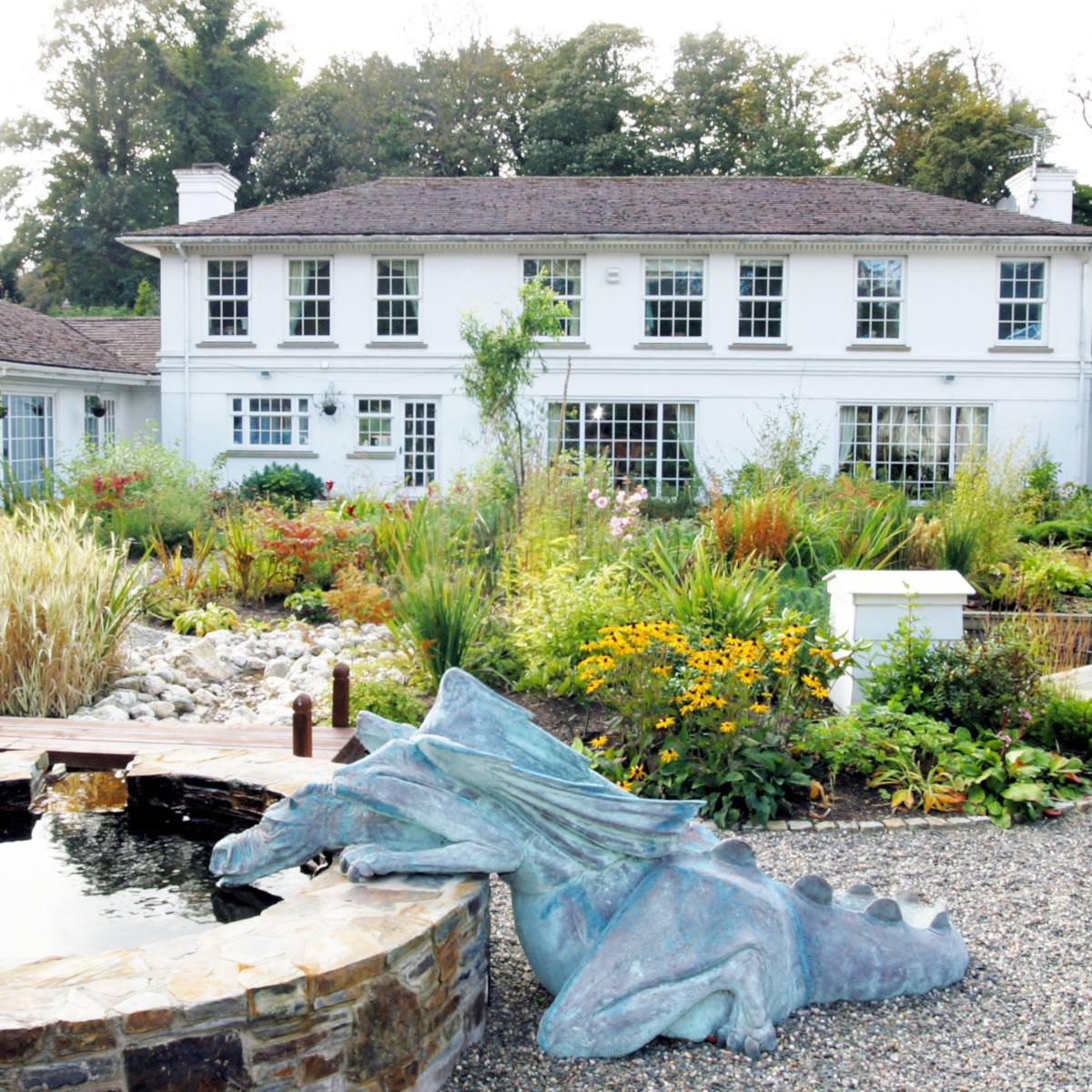 Beaufield House Garden design with dragon and pond
