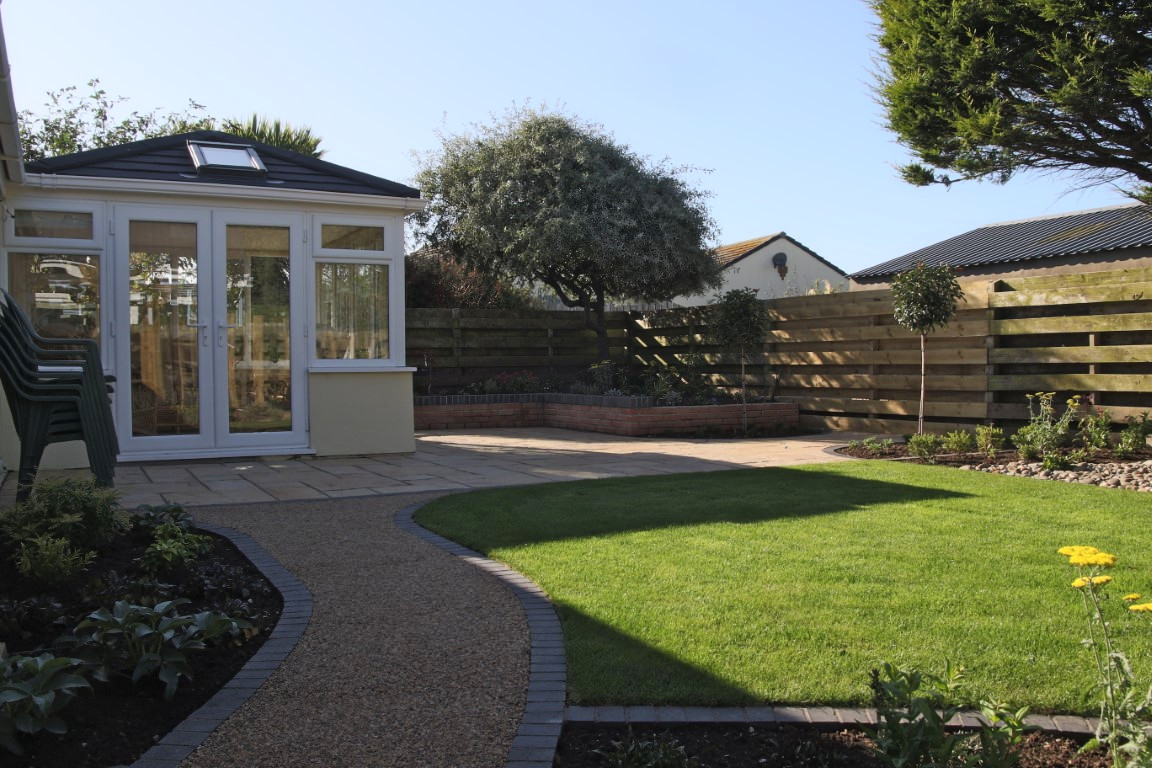 Patio and curved pathway outside conservatory